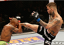 LAS VEGAS, NV - JANUARY 03:  (R-L) Cody Garbrandt kicks Marcus Brimage in their bantamweight bout during the UFC 182 event at the MGM Grand Garden Arena on January 3, 2015 in Las Vegas, Nevada.  (Photo by Josh Hedges/Zuffa LLC/Zuffa LLC via Getty Images)