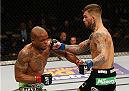 LAS VEGAS, NV - JANUARY 03:  (R-L) Cody Garbrandt punches Marcus Brimage in their bantamweight bout during the UFC 182 event at the MGM Grand Garden Arena on January 3, 2015 in Las Vegas, Nevada.  (Photo by Josh Hedges/Zuffa LLC/Zuffa LLC via Getty Images)