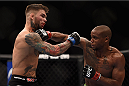 LAS VEGAS, NV - JANUARY 03:  (L) Cody Garbrandt and Marcus Brimage exchange punches in their bantamweight bout during the UFC 182 event at the MGM Grand Garden Arena on January 3, 2015 in Las Vegas, Nevada.  (Photo by Jeff Bottari/Zuffa LLC/Zuffa LLC via Getty Images)