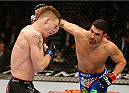 LAS VEGAS, NV - JANUARY 03:  (R-L) Danny Castillo punches Paul Felder in their lightweight bout during the UFC 182 event at the MGM Grand Garden Arena on January 3, 2015 in Las Vegas, Nevada.  (Photo by Josh Hedges/Zuffa LLC/Zuffa LLC via Getty Images)