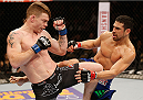 LAS VEGAS, NV - JANUARY 03:  (L-R) Paul Felder exchanges kicks with Danny Castillo in their lightweight bout during the UFC 182 event at the MGM Grand Garden Arena on January 3, 2015 in Las Vegas, Nevada.  (Photo by Josh Hedges/Zuffa LLC/Zuffa LLC via Getty Images)
