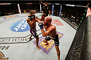 LAS VEGAS, NV - JANUARY 03:  (R-L) Josh Burkman punches Hector Lombard in their welterweight bout during the UFC 182 event on at the MGM Grand Garden Arena January 3, 2015 in Las Vegas, Nevada.  (Photo by Josh Hedges/Zuffa LLC/Zuffa LLC via Getty Images)