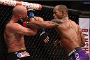 LAS VEGAS, NV - JANUARY 03:  (R) Hector Lombard punches Josh Burkman in their welterweight bout during the UFC 182 event on at the MGM Grand Garden Arena January 3, 2015 in Las Vegas, Nevada.  (Photo by Jeff Bottari/Zuffa LLC/Zuffa LLC via Getty Images)