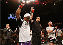 LAS VEGAS, NV - JANUARY 03:  (L-R) Hector Lombard celebrates his victory over Josh Burkman in their welterweight bout during the UFC 182 event on at the MGM Grand Garden Arena January 3, 2015 in Las Vegas, Nevada.  (Photo by Josh Hedges/Zuffa LLC/Zuffa LLC via Getty Images)