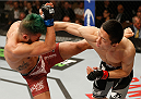 LAS VEGAS, NV - JANUARY 03:  (R-L) Kyoji Horiguchi punches Louis Gaudinot in their flyweight bout during the UFC 182 event on at the MGM Grand Garden Arena January 3, 2015 in Las Vegas, Nevada.  (Photo by Josh Hedges/Zuffa LLC/Zuffa LLC via Getty Images)