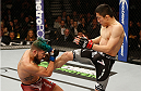 LAS VEGAS, NV - JANUARY 03:  (R) Kyoji Horiguchi kicks Louis Gaudinot in their flyweight bout during the UFC 182 event on at the MGM Grand Garden Arena January 3, 2015 in Las Vegas, Nevada.  (Photo by Josh Hedges/Zuffa LLC/Zuffa LLC via Getty Images)