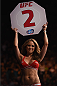 LAS VEGAS, NV - JANUARY 03:  UFC Octagon Girl Brittney Palmer announces the second round during the UFC 182 event at the MGM Grand Garden Arena on January 3, 2015 in Las Vegas, Nevada.  (Photo by Jeff Bottari/Zuffa LLC/Zuffa LLC via Getty Images)