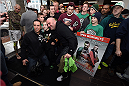 BOSTON, MA - JANUARY 15:  UFC President Dana White poses with fans at the open training session for the media at UFC Gym on January 15, 2015 in Boston, Massachusetts. (Photo by Jeff Bottari/Zuffa LLC/Zuffa LLC via Getty Images)