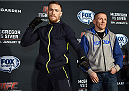 BOSTON, MA - JANUARY 16:  UFC featherweights Conor McGregor of Ireland (L) and Dennis Siver of Germany interact with media at Faneuil Hall on January 16, 2015 in Boston, Massachusetts. (Photo by Jeff Bottari/Zuffa LLC/Zuffa LLC via Getty Images)