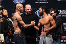 BOSTON, MA - JANUARY 17:  UFC lightweights Donald 'Cowboy' Cerrone (L) and Benson 'Smooth' Henderson face off during the UFC Fight Night Boston weigh-in event at the Orpheum Theatre on January 17, 2015 in Boston, Massachusetts. (Photo by Jeff Bottari/Zuffa LLC/Zuffa LLC via Getty Images)