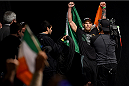 BOSTON, MA - JANUARY 17:  Conor 'The Notorious' McGregor of Ireland walks on stage holding an Irish flag during the UFC Fight Night Boston weigh-in event at the Orpheum Theatre on January 17, 2015 in Boston, Massachusetts. (Photo by Jeff Bottari/Zuffa LLC/Zuffa LLC via Getty Images)