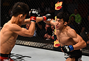 BOSTON, MA - JANUARY 18:  Joby Sanchez punches Tateki Matsuda in their flyweight fight during the UFC Fight Night event at the TD Garden on January 18, 2015 in Boston, Massachusetts. (Photo by Jeff Bottari/Zuffa LLC/Zuffa LLC via Getty Images)