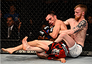 BOSTON, MA - JANUARY 18:  (R-L) Paddy Holohan tackles Shane Howell in their flyweight fight during the UFC Fight Night event at the TD Garden on January 18, 2015 in Boston, Massachusetts. (Photo by Jeff Bottari/Zuffa LLC/Zuffa LLC via Getty Images)