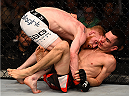 BOSTON, MA - JANUARY 18:  (L-R) Paddy Holohan tackles Shane Howell in their flyweight fight during the UFC Fight Night event at the TD Garden on January 18, 2015 in Boston, Massachusetts. (Photo by Jeff Bottari/Zuffa LLC/Zuffa LLC via Getty Images)
