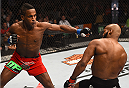 BOSTON, MA - JANUARY 18:  (L-R) Lorenz Larkin punches John Howard in their welterweight fight during the UFC Fight Night event at the TD Garden on January 18, 2015 in Boston, Massachusetts. (Photo by Jeff Bottari/Zuffa LLC/Zuffa LLC via Getty Images)
