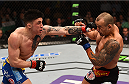 BOSTON, MA - JANUARY 18: (L-R) Norman Parke punches Gleison Tibau in their lightweight fight during the UFC Fight Night event at the TD Garden on January 18, 2015 in Boston, Massachusetts. (Photo by Jeff Bottari/Zuffa LLC/Zuffa LLC via Getty Images)