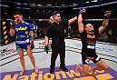 BOSTON, MA - JANUARY 18: (L-R) Gleison Tibau and Norman Parke react after Tibau defeated Parke in their lightweight fight during the UFC Fight Night event at the TD Garden on January 18, 2015 in Boston, Massachusetts. (Photo by Jeff Bottari/Zuffa LLC/Zuffa LLC via Getty Images)