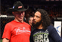 BOSTON, MA - JANUARY 18:  (L-R) Donald Cerrone and Benson Henderson embrace following their lightweight fight during the UFC Fight Night event at the TD Garden on January 18, 2015 in Boston, Massachusetts. (Photo by Jeff Bottari/Zuffa LLC/Zuffa LLC via Getty Images)
