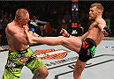 BOSTON, MA - JANUARY 18:  Conor McGregor of Ireland kicks Dennis Siver of Germany in their featherweight fight during the UFC Fight Night event at the TD Garden on January 18, 2015 in Boston, Massachusetts. (Photo by Jeff Bottari/Zuffa LLC/Zuffa LLC via Getty Images)