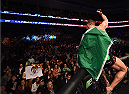 BOSTON, MA - JANUARY 18:  Conor McGregor of Ireland reacts after defeating Dennis Siver of Germany in their featherweight fight during the UFC Fight Night event at the TD Garden on January 18, 2015 in Boston, Massachusetts. (Photo by Jeff Bottari/Zuffa LLC/Zuffa LLC via Getty Images)