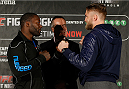 STOCKHOLM, SWEDEN - JANUARY 21:  (L-R) Opponents Anthony Johnson of the United States and Alexander Gustafsson of Sweden face off during the UFC Ultimate Media Day at the Tele2 Arena on January 21, 2015 in Stockholm, Sweden. (Photo by Josh Hedges/Zuffa LLC/Zuffa LLC via Getty Images)
