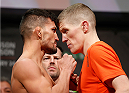STOCKHOLM, SWEDEN - JANUARY 23:  (L-R) Opponents Mirsad Bektic of Bosnia and Paul Redmond of Ireland face off during the UFC Fight Night Weigh-ins at the Hovet Arena on January 23, 2015 in Stockholm, Sweden. (Photo by Josh Hedges/Zuffa LLC/Zuffa LLC via Getty Images)