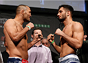STOCKHOLM, SWEDEN - JANUARY 23:  (L-R) Opponents Dan Henderson of the United States and Gegard Mousasi of the Netherlands face off during the UFC Fight Night Weigh-ins at the Hovet Arena on January 23, 2015 in Stockholm, Sweden. (Photo by Josh Hedges/Zuffa LLC/Zuffa LLC via Getty Images)