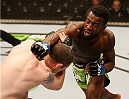 STOCKHOLM, SWEDEN - JANUARY 24:  (R-L) Chris Beal of the United States punches Neil Serry of Ireland in their flyweight bout during the UFC Fight Night event at the Tele2 Arena on January 24, 2015 in Stockholm, Sweden. (Photo by Josh Hedges/Zuffa LLC/Zuffa LLC via Getty Images)
