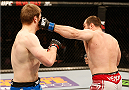 STOCKHOLM, SWEDEN - JANUARY 24:  (R-L) Konstantin Erokhin of Russia punches Viktor Pesta of the Czech Republic in their heavyweight bout during the UFC Fight Night event at the Tele2 Arena on January 24, 2015 in Stockholm, Sweden. (Photo by Josh Hedges/Zuffa LLC/Zuffa LLC via Getty Images)