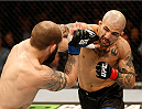 STOCKHOLM, SWEDEN - JANUARY 24:  (R-L) Akira Corassani of Sweden punches Sam Sicilia of the United States in their featherweight bout during the UFC Fight Night event at the Tele2 Arena on January 24, 2015 in Stockholm, Sweden. (Photo by Josh Hedges/Zuffa LLC/Zuffa LLC via Getty Images)
