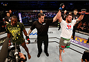STOCKHOLM, SWEDEN - JANUARY 24:  Ryan Bader (R) of the United States celebrates after his split-decision victory over Phil Davis of the United States in their light heavyweight bout during the UFC Fight Night event at the Tele2 Arena on January 24, 2015 in Stockholm, Sweden. (Photo by Josh Hedges/Zuffa LLC/Zuffa LLC via Getty Images)