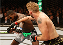 STOCKHOLM, SWEDEN - JANUARY 24:  (R-L) Alexander Gustafsson of Sweden punches Anthony Johnson of the United States in their light heavyweight bout during the UFC Fight Night event at the Tele2 Arena on January 24, 2015 in Stockholm, Sweden. (Photo by Josh Hedges/Zuffa LLC/Zuffa LLC via Getty Images)