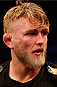 STOCKHOLM, SWEDEN - JANUARY 24:  Alexander Gustafsson of Sweden reacts after his TKO loss to Anthony Johnson of the United States in their light heavyweight bout during the UFC Fight Night event at the Tele2 Arena on January 24, 2015 in Stockholm, Sweden. (Photo by Josh Hedges/Zuffa LLC/Zuffa LLC via Getty Images)