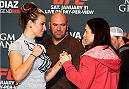LAS VEGAS, NEVADA - JANUARY 29:  (L-R) Opponents Miesha Tate and Sara McMann face off during the UFC 183 Ultimate Media Day at the MGM Grand Hotel/Casino on January 29, 2015 in Las Vegas, Nevada. (Photo by Josh Hedges/Zuffa LLC/Zuffa LLC via Getty Images)