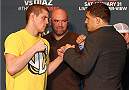 LAS VEGAS, NEVADA - JANUARY 29:  (L-R) Opponents Joe Lauzon and Al Iaquinta face off during the UFC 183 Ultimate Media Day at the MGM Grand Hotel/Casino on January 29, 2015 in Las Vegas, Nevada. (Photo by Josh Hedges/Zuffa LLC/Zuffa LLC via Getty Images)