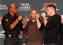 LAS VEGAS, NEVADA - JANUARY 29:  (L-R) Opponents Anderson Silva of Brazil and Nick Diaz face off during the UFC 183 Ultimate Media Day at the MGM Grand Hotel/Casino on January 29, 2015 in Las Vegas, Nevada. (Photo by Josh Hedges/Zuffa LLC/Zuffa LLC via Getty Images)