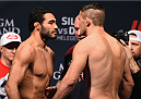 LAS VEGAS, NV - JANUARY 30:  (L-R) Rafael Natal and Tom Watson face off during the UFC 183 weigh-in at the MGM Grand Garden Arena on January 30, 2015 in Las Vegas, Nevada.  (Photo by Josh Hedges/Zuffa LLC/Zuffa LLC via Getty Images)