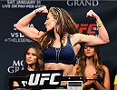 LAS VEGAS, NV - JANUARY 30:  Miesha Tate steps on the scale during the UFC 183 weigh-in at the MGM Grand Garden Arena on January 30, 2015 in Las Vegas, Nevada.  (Photo by Josh Hedges/Zuffa LLC/Zuffa LLC via Getty Images)