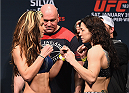 LAS VEGAS, NV - JANUARY 30:  (L-R) Miesha Tate and Sara McMann face off during the UFC 183 weigh-in at the MGM Grand Garden Arena on January 30, 2015 in Las Vegas, Nevada.  (Photo by Josh Hedges/Zuffa LLC/Zuffa LLC via Getty Images)