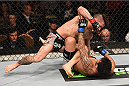 LAS VEGAS, NV - JANUARY 31:  Ian McCall (top) punches John Lineker in their flyweight bout during the UFC 183 event at the MGM Grand Garden Arena on January 31, 2015 in Las Vegas, Nevada.  (Photo by Josh Hedges/Zuffa LLC/Zuffa LLC via Getty Images) *** Local Caption *** Ian McCall; John Lineker