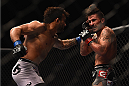 LAS VEGAS, NV - JANUARY 31:  (L-R) John Lineker punches Ian McCall in their flyweight bout during the UFC 183 event at the MGM Grand Garden Arena on January 31, 2015 in Las Vegas, Nevada.  (Photo by Jeff Bottari/Zuffa LLC/Zuffa LLC via Getty Images) *** Local Caption *** Ian McCall; John Lineker