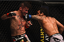 LAS VEGAS, NV - JANUARY 31:  (R-L) John Lineker punches Ian McCall in their flyweight bout during the UFC 183 event at the MGM Grand Garden Arena on January 31, 2015 in Las Vegas, Nevada.  (Photo by Jeff Bottari/Zuffa LLC/Zuffa LLC via Getty Images) *** Local Caption *** Ian McCall; John Lineker