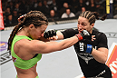 LAS VEGAS, NV - JANUARY 31:  (R-L) Sara McMann punches Miesha Tate in their women's bantamweight bout during the UFC 183 event at the MGM Grand Garden Arena on January 31, 2015 in Las Vegas, Nevada.  (Photo by Josh Hedges/Zuffa LLC/Zuffa LLC via Getty Images) *** Local Caption *** Miesha Tate; Sara McMann