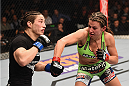 LAS VEGAS, NV - JANUARY 31:  (R-L) Miesha Tate punches Sara McMann in their women's bantamweight bout during the UFC 183 event at the MGM Grand Garden Arena on January 31, 2015 in Las Vegas, Nevada.  (Photo by Josh Hedges/Zuffa LLC/Zuffa LLC via Getty Images) *** Local Caption *** Miesha Tate; Sara McMann