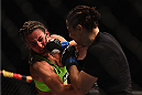 LAS VEGAS, NV - JANUARY 31:  (R-L) Sara McMann punches Miesha Tate in their women's bantamweight bout during the UFC 183 event at the MGM Grand Garden Arena on January 31, 2015 in Las Vegas, Nevada.  (Photo by Jeff Bottari/Zuffa LLC/Zuffa LLC via Getty Images) *** Local Caption *** Miesha Tate; Sara McMann