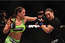 LAS VEGAS, NV - JANUARY 31:  (L-R) Miesha Tate punches Sara McMann in their women's bantamweight bout during the UFC 183 event at the MGM Grand Garden Arena on January 31, 2015 in Las Vegas, Nevada.  (Photo by Jeff Bottari/Zuffa LLC/Zuffa LLC via Getty Images) *** Local Caption *** Miesha Tate; Sara McMann