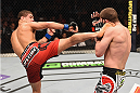 LAS VEGAS, NV - JANUARY 31:  (L-R) Al Iaquinta kicks Joe Lauzon in their lightweight bout during the UFC 183 event at the MGM Grand Garden Arena on January 31, 2015 in Las Vegas, Nevada.  (Photo by Josh Hedges/Zuffa LLC/Zuffa LLC via Getty Images) *** Local Caption *** Joe Lauzon; Al Iaquinta