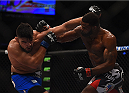 LAS VEGAS, NV - JANUARY 31:  (L-R) Kelvin Gastelum and Tyron Woodley exchange punches in their welterweight bout during the UFC 183 event at the MGM Grand Garden Arena on January 31, 2015 in Las Vegas, Nevada.  (Photo by Jeff Bottari/Zuffa LLC/Zuffa LLC via Getty Images) *** Local Caption *** Tyron Woodley; Kelvin Gastelum