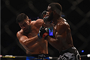 LAS VEGAS, NV - JANUARY 31:  (R-L) Tyron Woodley punches Kelvin Gastelum in their welterweight bout during the UFC 183 event at the MGM Grand Garden Arena on January 31, 2015 in Las Vegas, Nevada.  (Photo by Jeff Bottari/Zuffa LLC/Zuffa LLC via Getty Images) *** Local Caption *** Tyron Woodley; Kelvin Gastelum