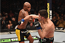 LAS VEGAS, NV - JANUARY 31:  (L-R)  Anderson Silva punches Nick Diaz in their middleweight bout during the UFC 183 event at the MGM Grand Garden Arena on January 31, 2015 in Las Vegas, Nevada.  (Photo by Josh Hedges/Zuffa LLC/Zuffa LLC via Getty Images) *** Local Caption *** Anderson Silva; Nick Diaz